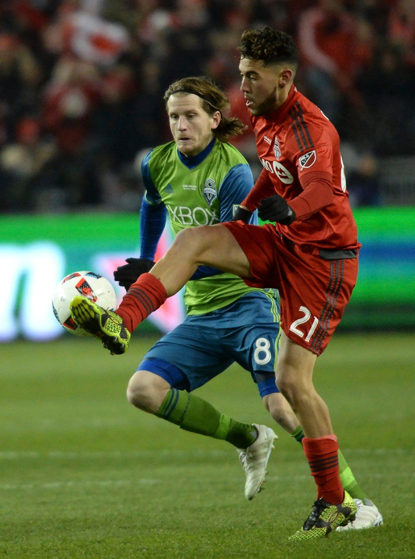 Toronto FC midfielder Jonathan Osorio (21) plays the ball as Seattle Sounders midfielder Erik Friberg (8) looks on during first-half MLS Cup final soccer action in Toronto, Saturday, Dec. 10, 2016. (Nathan Denette/The Canadian Press via AP)