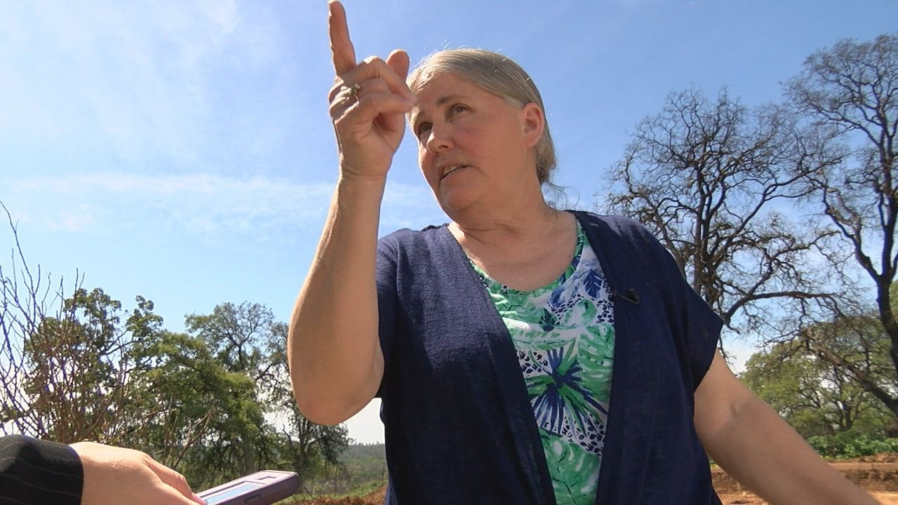 Marjorie Daley points to where she saw the LaPorte Fire
