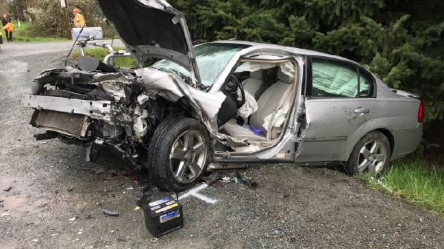 Driver extricated after head-on collision on Rogue River Highway