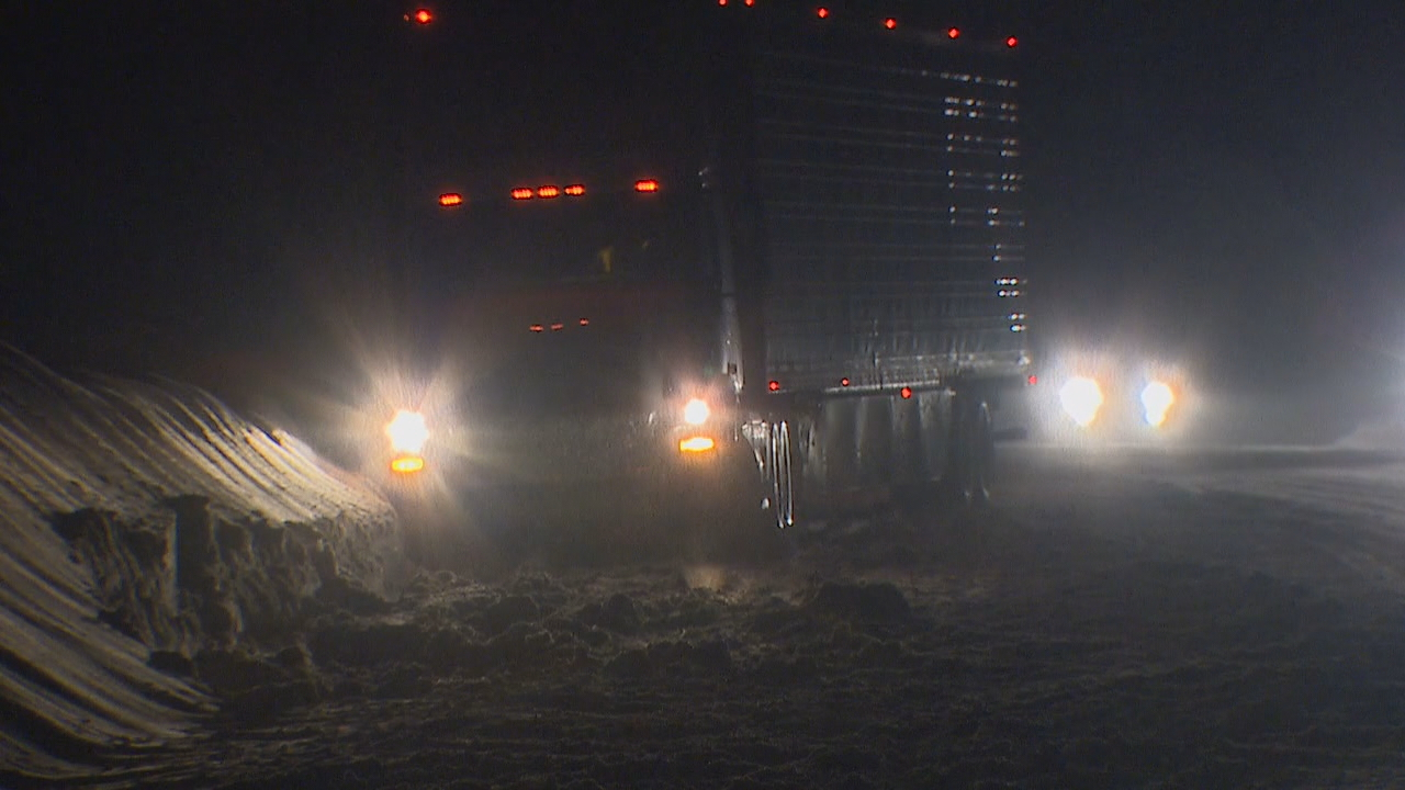 The passes were a mess of freezing rain and snow Thursday night. Some cars and tractor trailers had trouble getting through Snoqualmie Pass. (Photo: KOMO News)