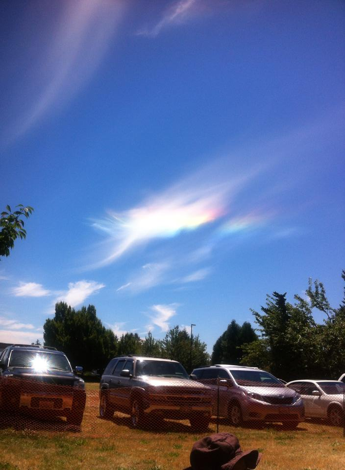 "These colorful clouds are called ""Circumhorizontal arcs"" or, more informally, ""Fire Rainbows."" They're caused by the ice crystals in the cloud being at just the correct angle to the sun to refract the light into the colors of the rainbow. More details here:. (Photo courtesy: Jaime Birgin-Bautista, Kent, Wash. July 1, 2014)"