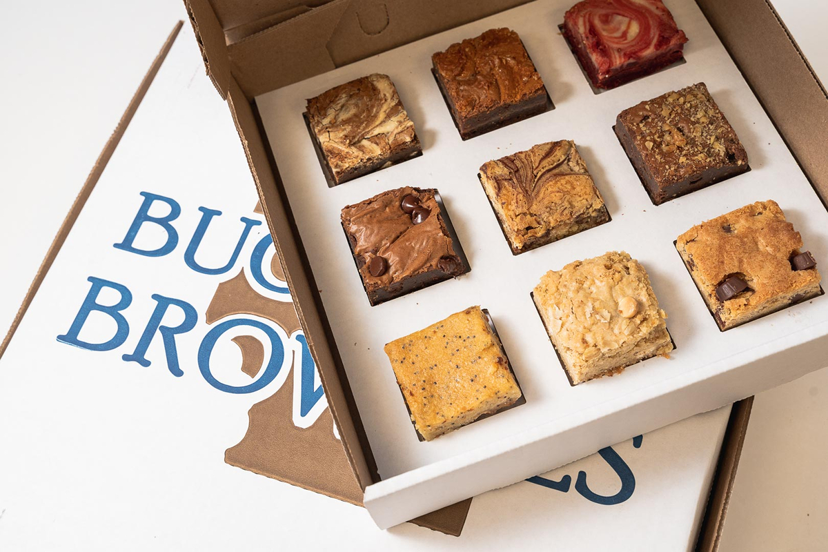 Buckabee offers nine beloved brownie varieties daily, including chocolate & walnut, fudgy chocolate, and marble. On certain days of the week, you'll find interesting flavors like red velvet cream cheese, cookies & cream, and raspberry & white chocolate. They also offer their own house blend coffee. / Image courtesy of Buckabee Brownies // Published: 6.6.19