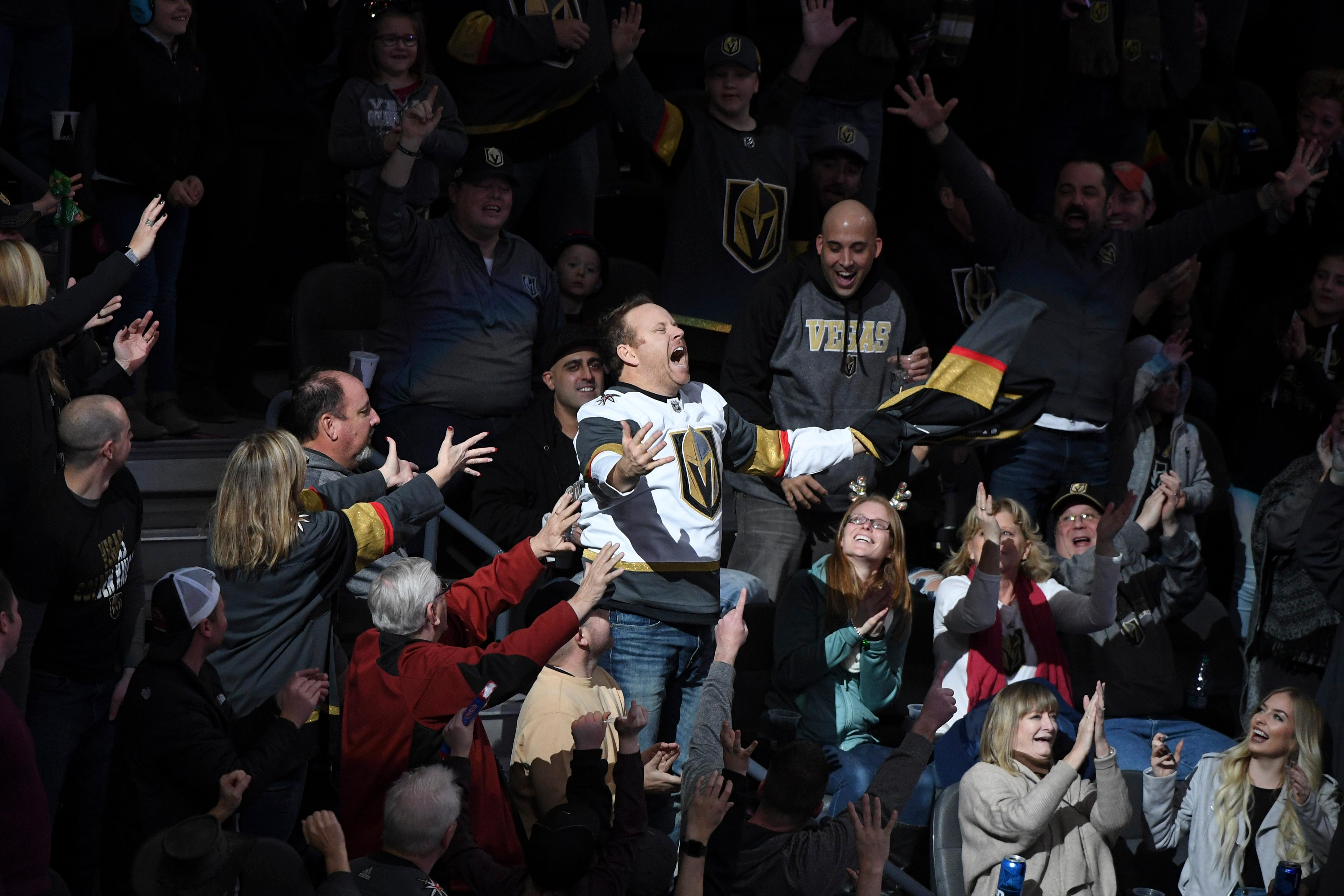 Sports entertainer Cameron Hughes gets the crowd excited as he tosses out jerseys during the Vegas Golden Knights NHL hockey game against the Washington Capitals Saturday, December 23, 2017, at T-Mobile Arena in Las Vegas.  CREDIT: Sam Morris/Las Vegas News Bureau
