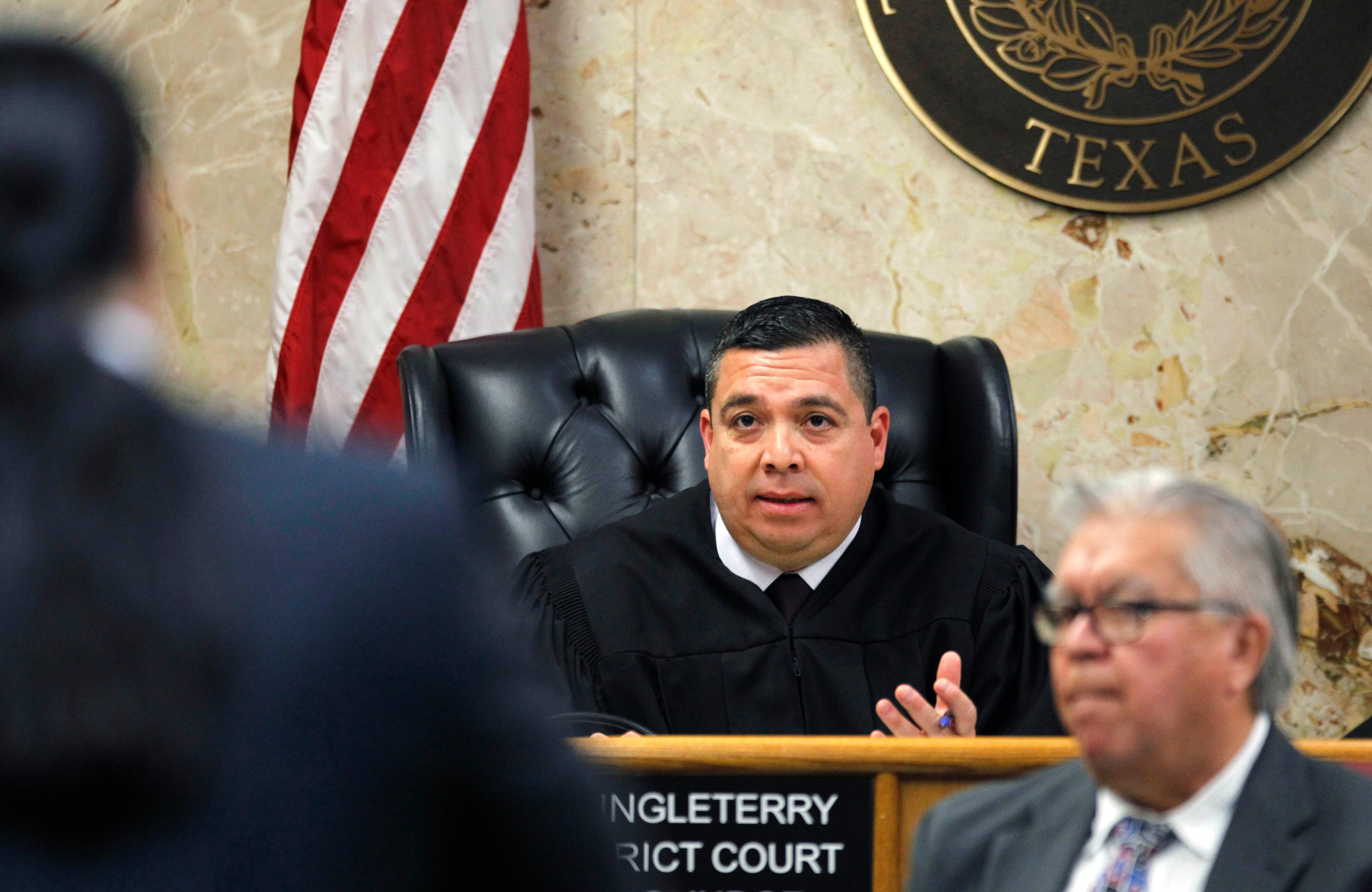92nd state District Court Judge Luis Singleterry denies defense attorney O. Rene Flores' motion for a mistrial of John Bernard Feit's trial for the 1960 murder of Irene Garza Wednesday, December 6, 2017, at the Hidalgo County Courthouse in Edinburg.                 (Nathan Lambrecht/The Monitor/Pool)