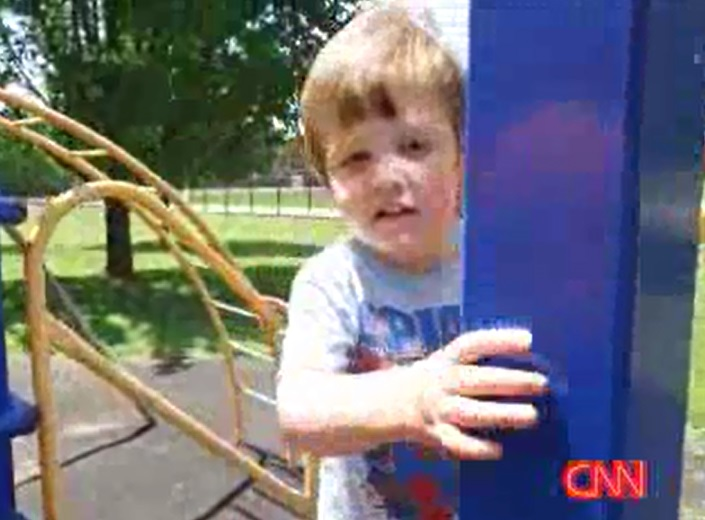 In a park on a robbery call, Topeka, Kansas officer Aaron Bulmer saved 3-year-old Elijah Hamby from drowning in a pond. (CNN Newsource)