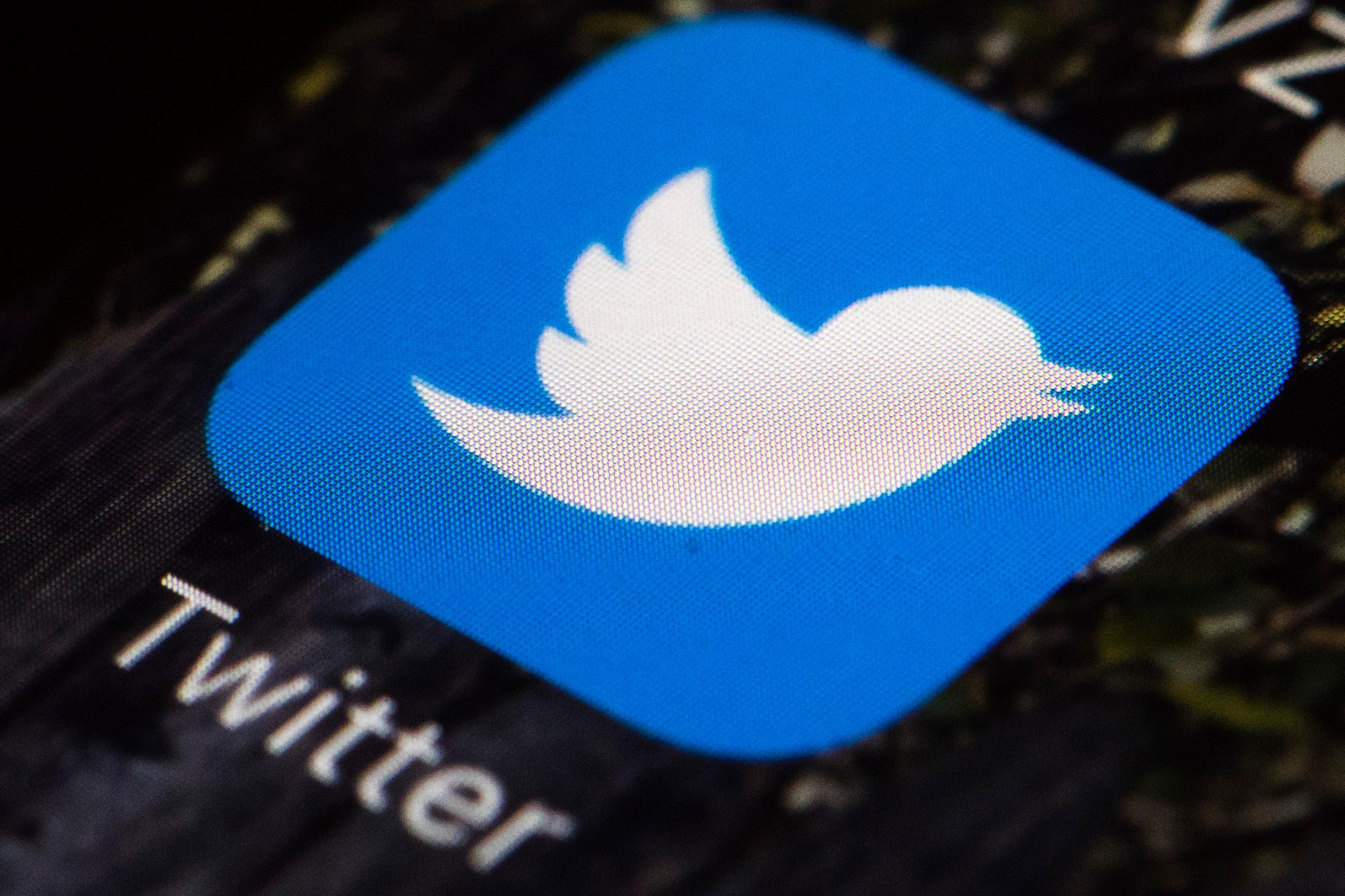 FILE- This April 26, 2017, file photo shows the Twitter icon on a mobile phone, in Philadelphia.{ } (AP Photo/Matt Rourke, File)