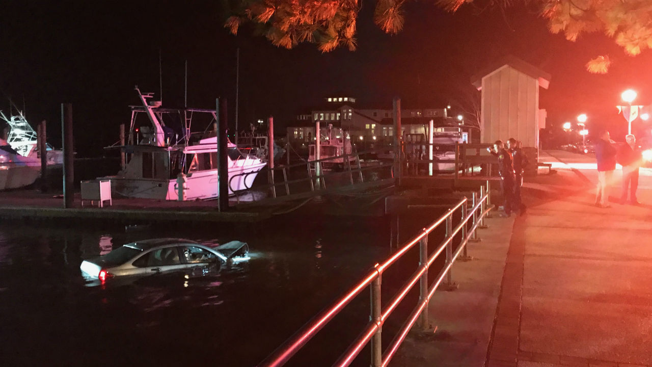 Crews pulled the car out of the Neuse after the driver, whose name has not been released, veered off the road near the Persimmons Waterfront Restaurant parking lot.  (Dare Oliver, NewsChannel 12 photo)<p></p>