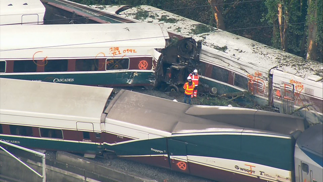 KOMO Photo of derailed Amtrak train near DuPont, Wash.{ }