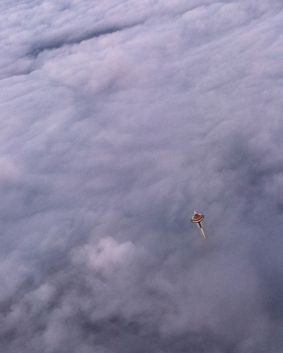 Space Needle pokes above a fog layer as seen from a plane coming into Sea-Tac Airport (Photo: YouNews contributor GBolt76)