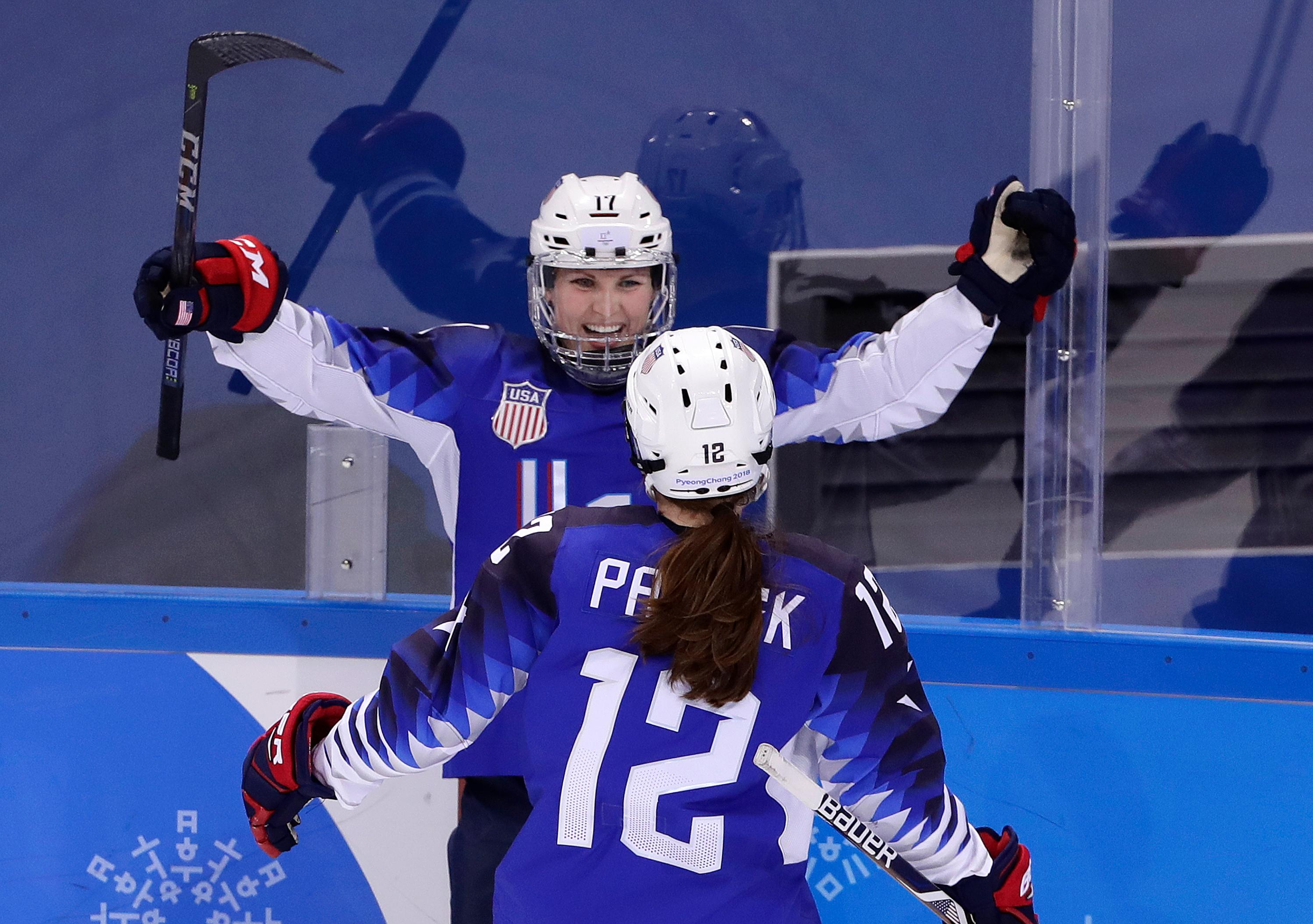 Jocelyne Lamoureux-Davidson (17), of the United States, celebrates her second goal against the team from Russia with Kelly Pannek (12) during the second period of the preliminary round of the women's hockey game at the 2018 Winter Olympics in Gangneung, South Korea, Tuesday, Feb. 13, 2018. (AP Photo/Frank Franklin II)