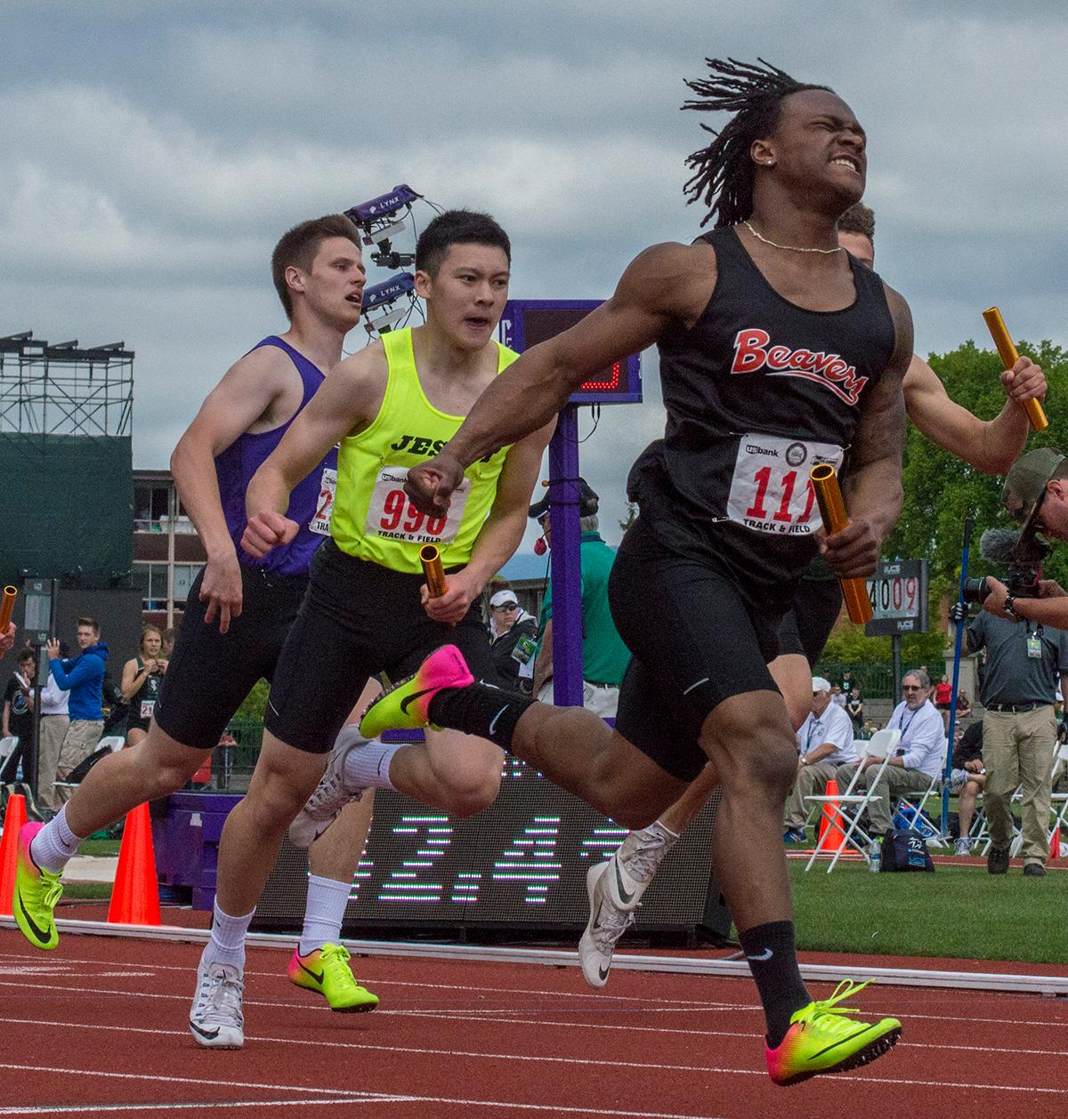 Anthony Albright of Beaverton High School finishes the 6A Boys 4x100 Meter Relay race. Beaverton's relay team (Mataio Talalemotu, Carson Crawford, Lucas Radostitz, and Anthony Albright) takes first with a time of 42.41 at the OSAA Track and Field Championships at Hayward Field. Photo by Emily Gonzalez, Oregon News Lab.