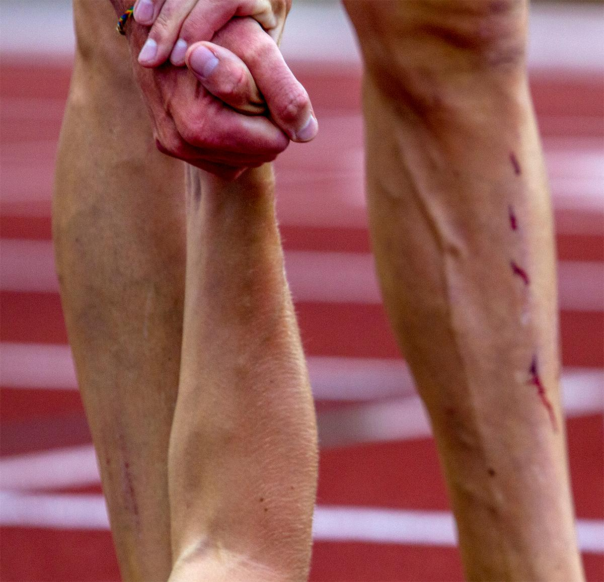 Two athletes extend a hand to each other at the finish of the 10,000 meter final. The race was won by Tulsa's Marc Scott with a time of 29:01.54. Photo by August Frank, Oregon News Lab