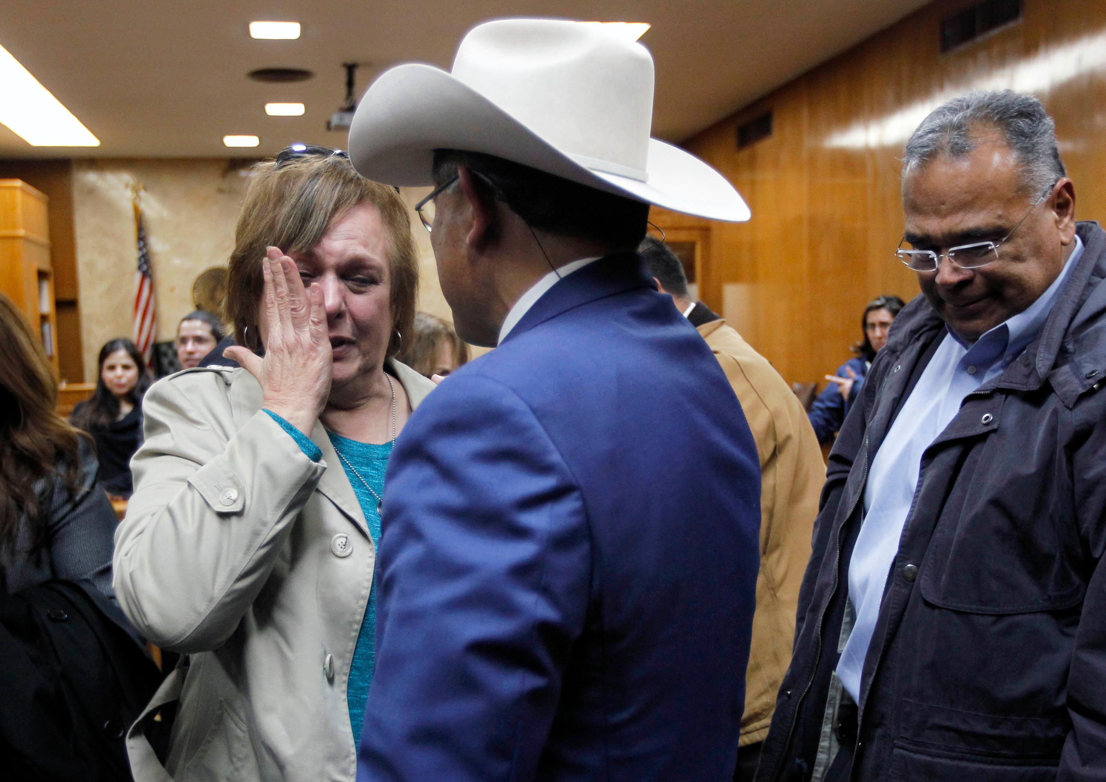 Noemi Sigler cries while talking with Texas Ranger Rudy Jaramillo, center, following the guilty verdict in John Bernard Feit's trial for the 1960 murder of Irene Garza in the 92nd state District Court Thursday, December 7, 2017, at the Hidalgo County Courthouse in Edinburg. Sigler is a relative of Irene Garza, Jaramillo worked on the Garza case before it was brought to trial.  (Nathan Lambrecht/The Monitor/Pool)