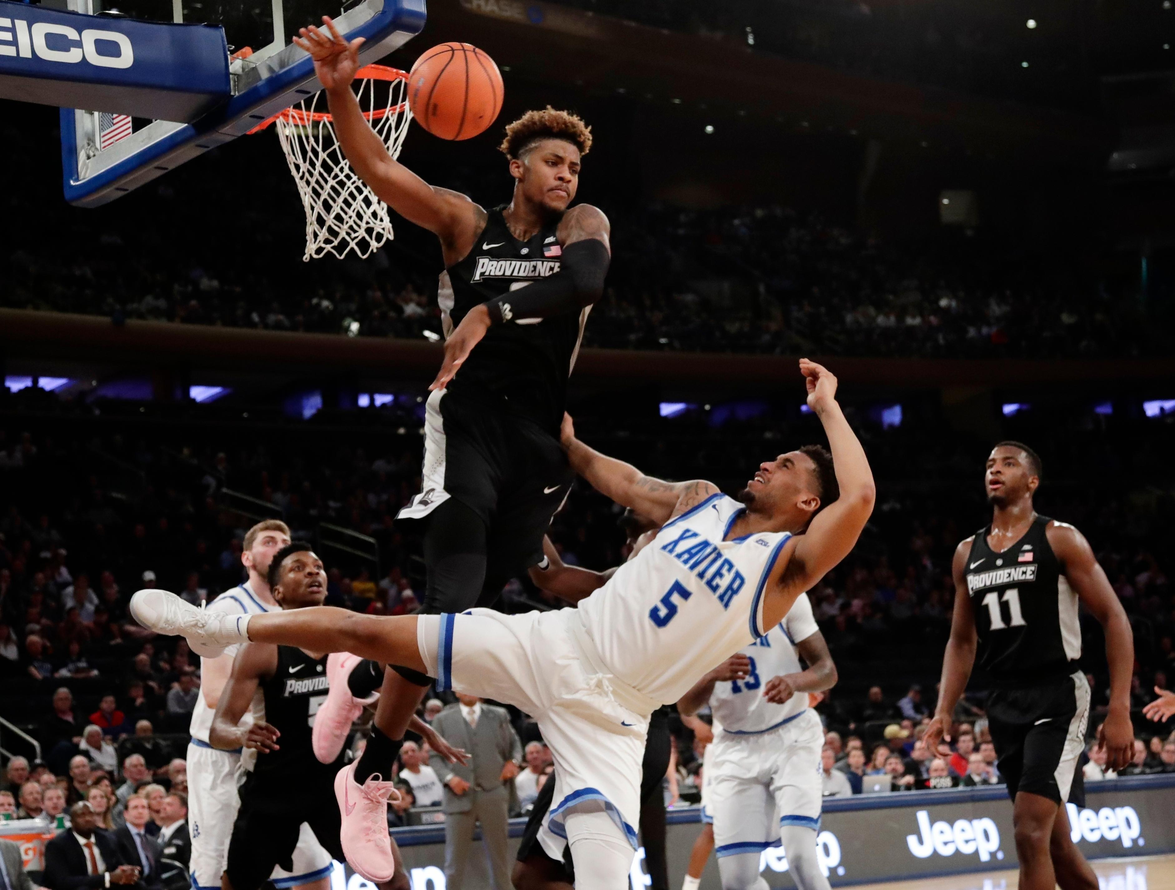 Providence's Nate Watson (0) defends against Xavier's Trevon Bluiett (5) during the first half of an NCAA college basketball game in the Big East men's tournament semifinals Friday, March 9, 2018, in New York. (AP Photo/Frank Franklin II)