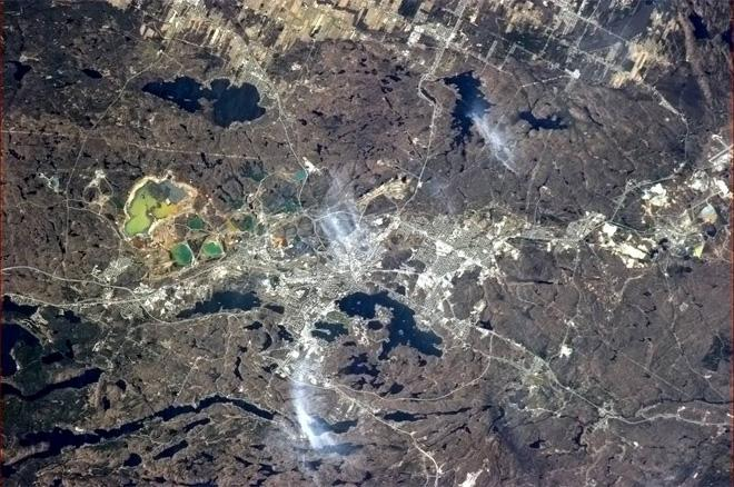 Sudbury, Ontario, rich in nickel and copper, the ore put there by an asteroid impact 2 billion years ago. (Photo & Caption: Col. Chris Hadfield, NASA)