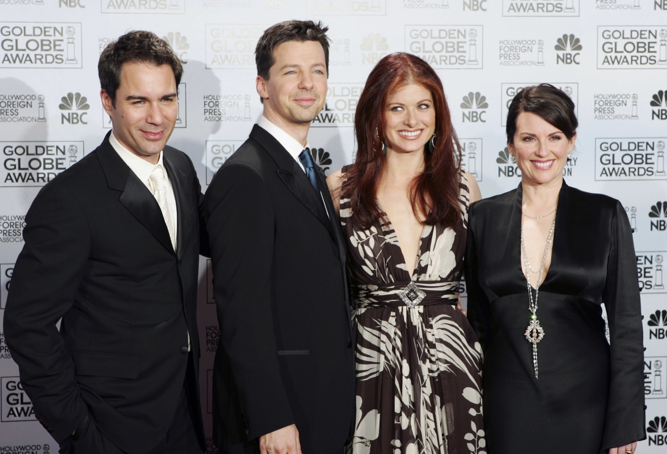 "FILE - In this Jan. 16, 2006, file photo, cast members from the comedy series ""Will & Grace,"" from left, Eric McCormack, Sean Hayes, Debra Messing and Megan Mullally, pose backstage after making an award presentation at the 63rd Annual Golden Globe Awards in Beverly Hills, Calif. The stars of ""Will & Grace"" gave fans a behind the scenes glimpse at production of the series' revival on the weekend of March 5, 2017. (AP Photo/Reed Saxon, File)"