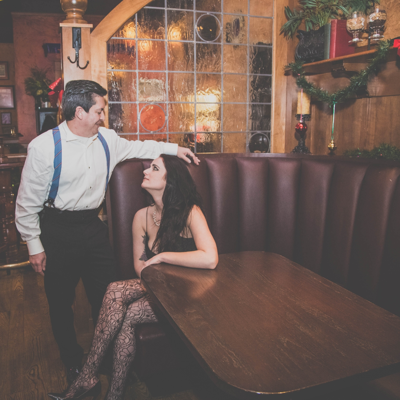 Bobby Romell in an Oscar de la Renta tuxedo, and Katelyn Bostick in a dress by Paper Crane with accessories from White House Black Market at The Pub in Rookwood. / Image: Catherine Viox // Published: 12.23.16