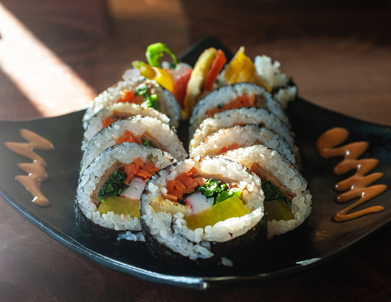 Gimbap: rice seasoned with salt and sesame oil and rolled up in a sheet of roast seaweed with egg, crab meat, spinach, carrots, and pickled yellow raddish / Image: Kellie Coleman // Published: 12.29.20<p></p>