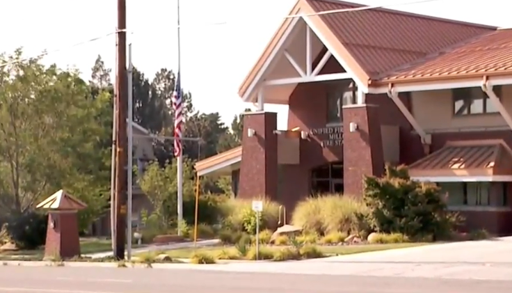 Flags at the Unified Fire Authority headquarters were lowered to half-staff on Tuesday, August 14, 2018 in honor of fallen firefighter Matt Burchett, who spent 20 years working for UFA before moving to Draper City Fire. (Photo: KUTV)