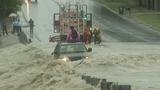 Emergency crews work to save drivers from flood waters in Texas