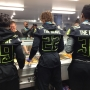 UO football players serve meals at Eugene Mission