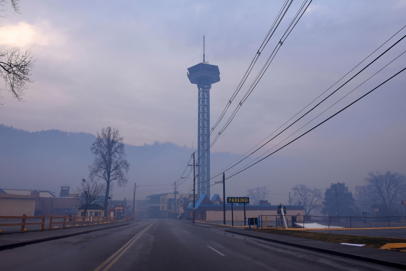 Smoke from wildfires fill the air around Gatlinburg, Tenn., on  Tuesday, Nov. 29, 2016.  Rain had begun to fall in some areas, but experts predicted it would not be enough to end the relentless drought that has spread across several Southern states and provided fuel for fires now burning for weeks in states including Tennessee, Georgia and North Carolina. (Michael Patrick/Knoxville News Sentinel via AP)