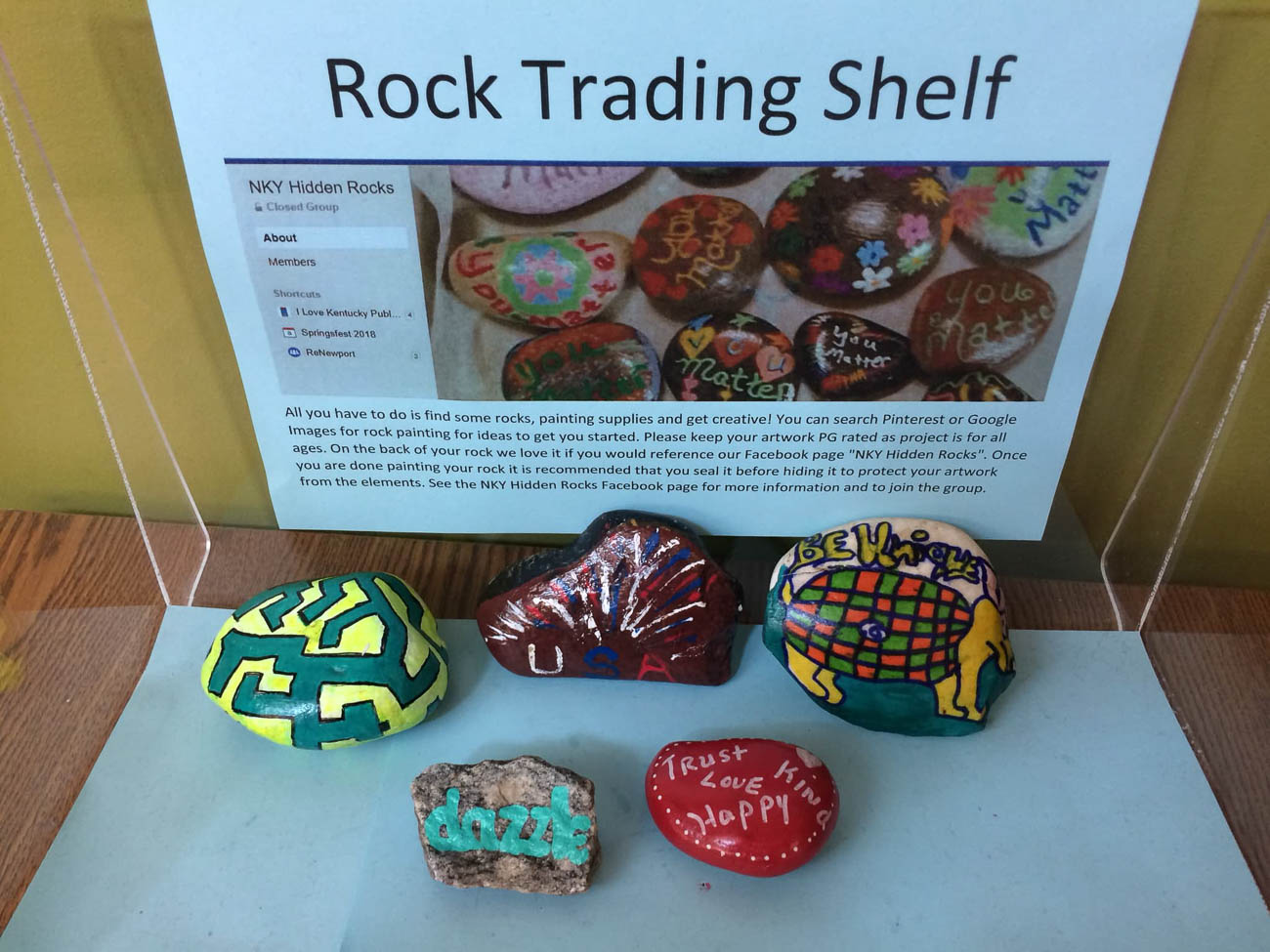Some local businesses let NKY Hidden Rocks set up a stand where people can trade rocks or find new ones for those who may have limited mobility or can't go out to collect them for themselves. / Image: Kathy Moore // Published: 8.17.19