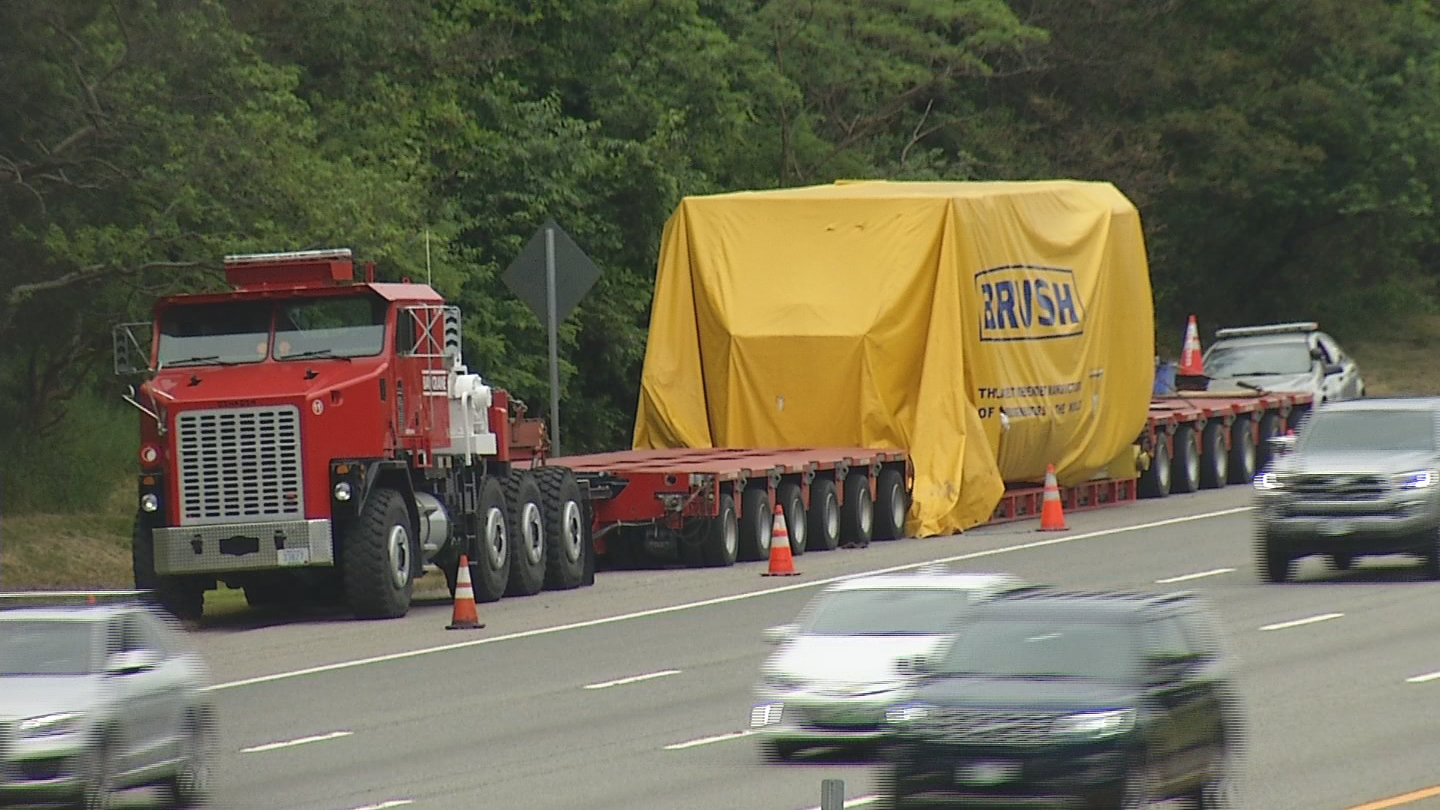 A truck hauling a generator is stopped on Interstate 95 in Warwick because it's too heavy for any of the state's bridges. (WJAR)