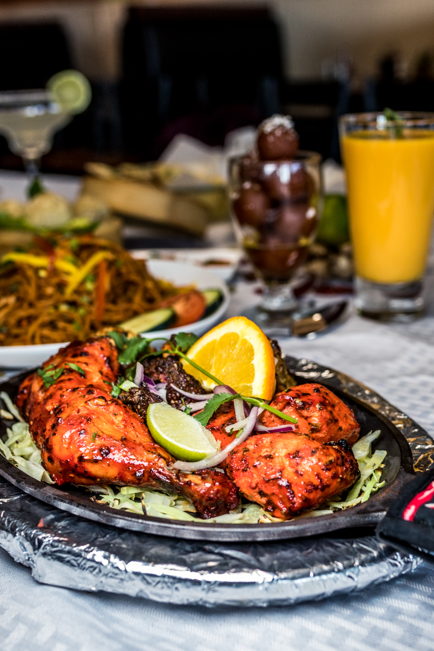 Non-Veg Platter: Tandori chicken, malai tikka, chicken tikka, and lamb chops served on a sizzler hot plate with two kinds of chutneys and naan bread / Image: Catherine Viox{ }// Published: 2.6.20