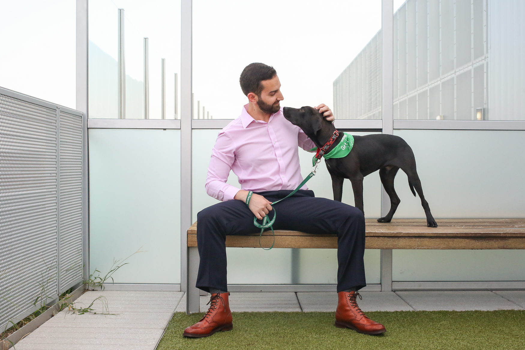 Meet Podge and Michael, a 9-month-old lab mix and a 31-year-old human respectively. Photo location: City Market at O Apartments Rooftop Dog Park (Image: Amanda Andrade-Rhoades/ DC Refined)