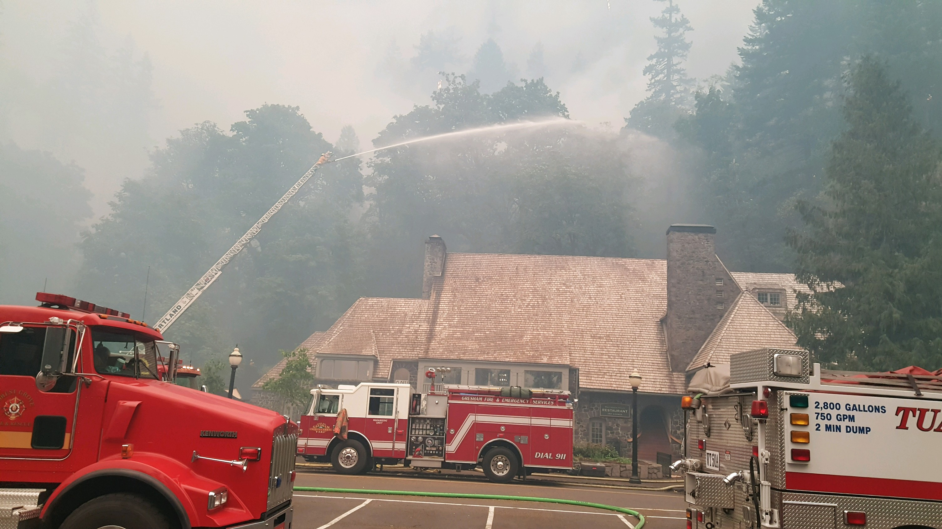 Historic Multnomah Falls Lodge is still standing in the Columbia River Gorge after a close encounter with the Eagle Creek Fire. (courtesy Eugene-Springfield Fire Dept.)