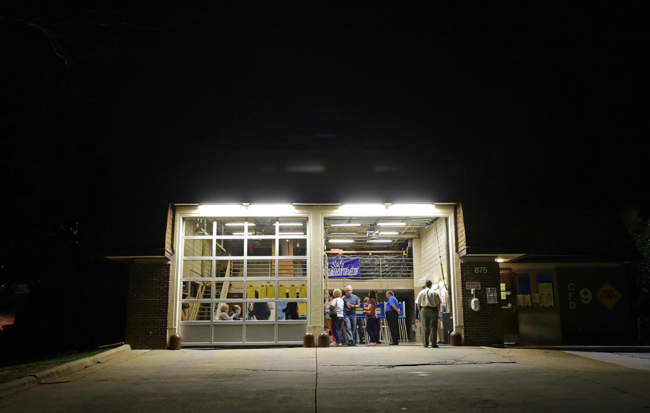 Voters line up before daylight to cast their ballots at Cary Fire Station 9 in Cary, N.C., Tuesday, March 15, 2016. (AP Photo/Gerry Broome)
