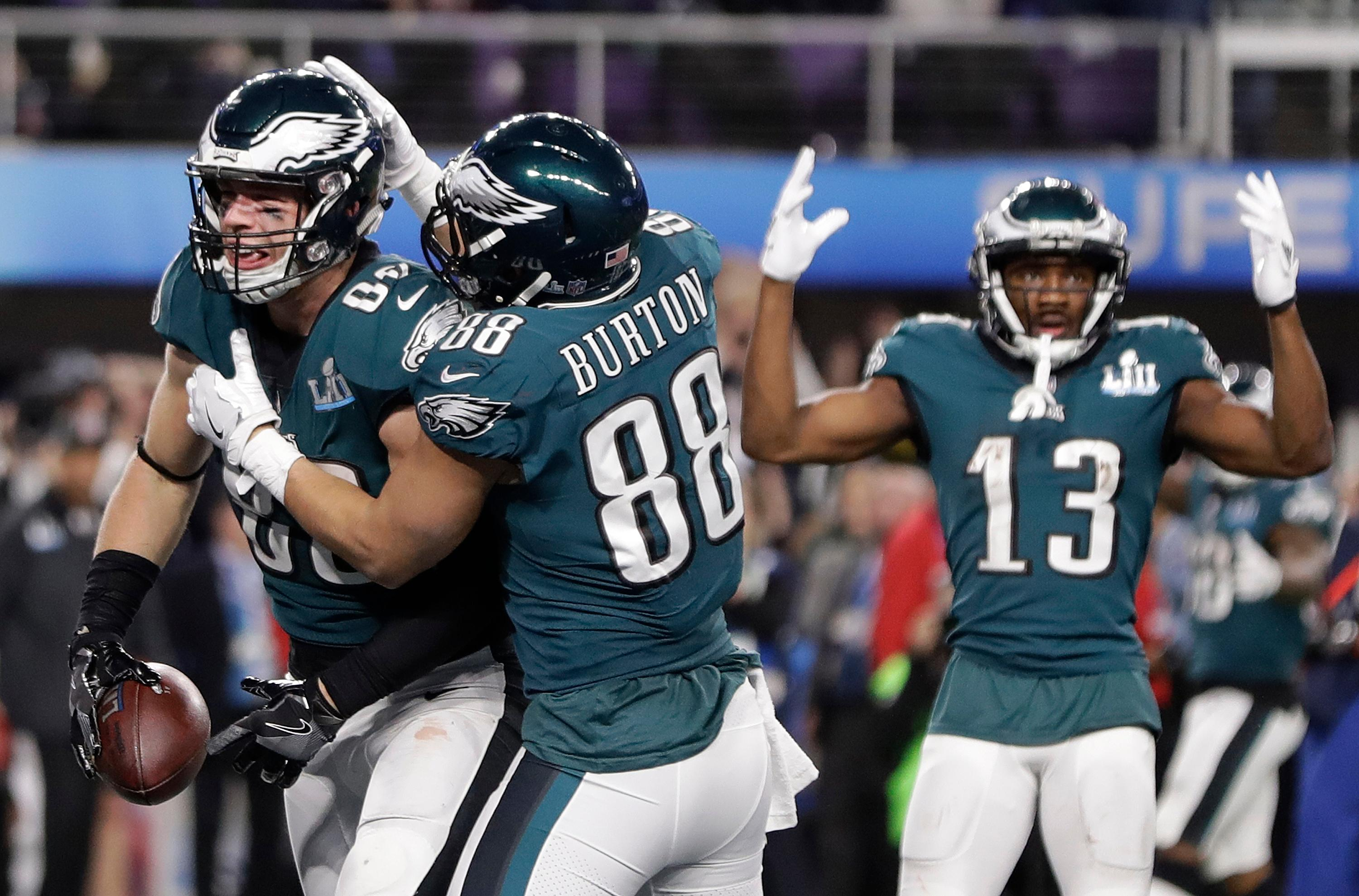 Philadelphia Eagles' Zach Ertz, left, celebrates his touchdown catch during the second half of the NFL Super Bowl 52 football game against the New England Patriots Sunday, Feb. 4, 2018, in Minneapolis. (AP Photo/Mark Humphrey)