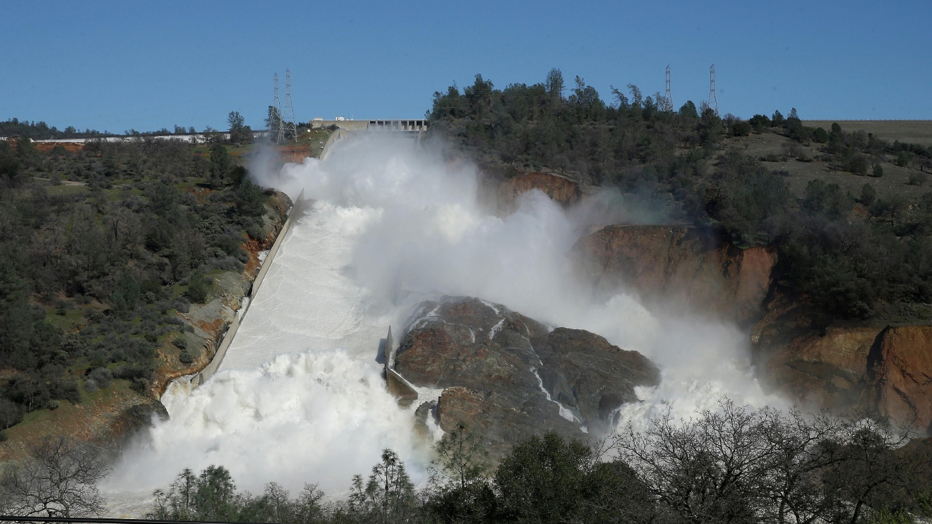 "In this Saturday, Feb. 11, 2017, water flows down Oroville Dam's main spillway near Oroville, Calif. Officials have ordered residents near the Oroville Dam in Northern California to evacuate the area Sunday, Feb. 12, saying a ""hazardous situation is developing"" after an emergency spillway severely eroded. (AP Photo/Rich Pedroncelli)"