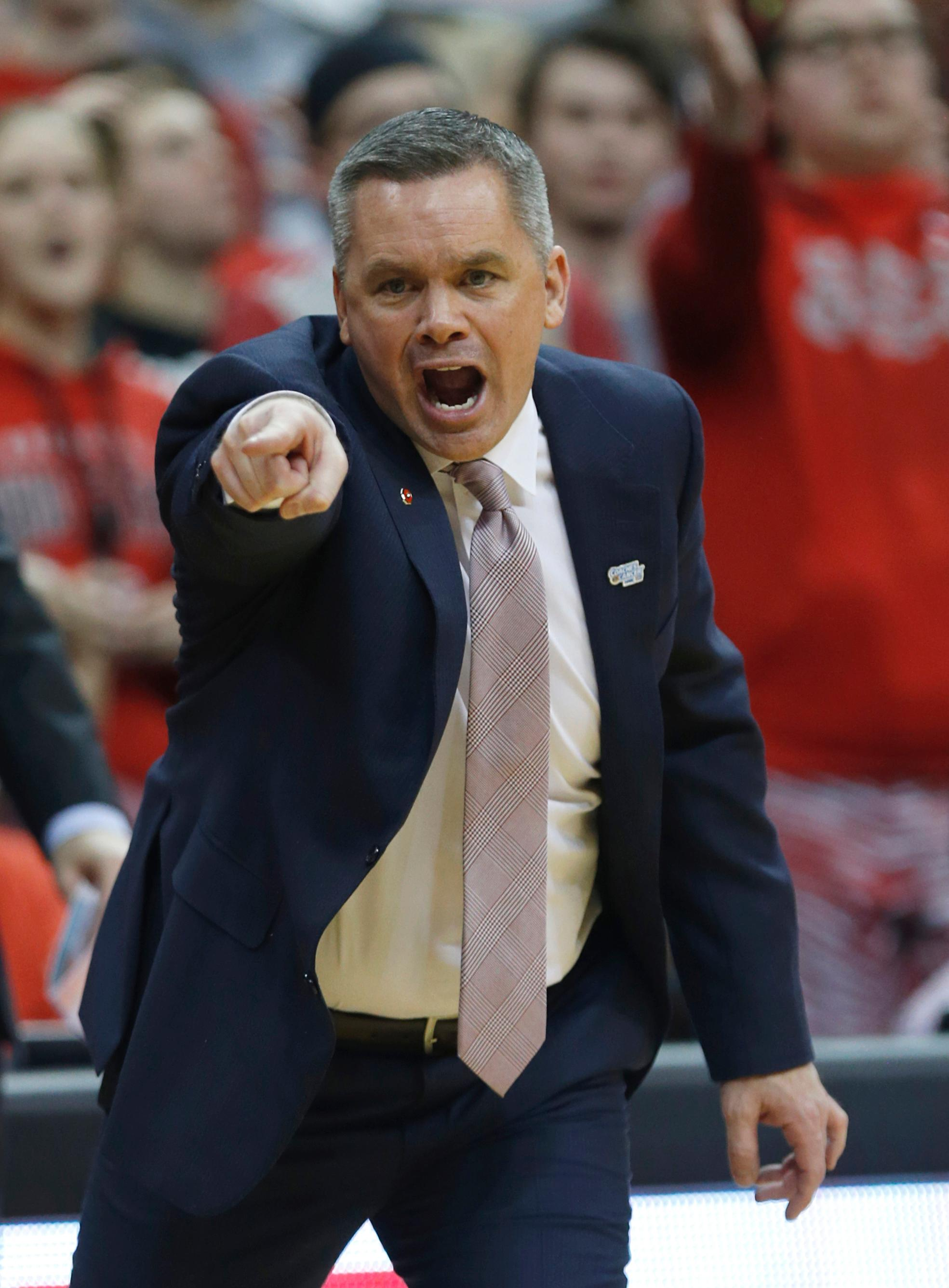 FILE - In this Jan. 25, 2018, file photo, Ohio State coach Chris Holtmann reacts to a call during the second half of an NCAA college basketball game against Penn State, in Columbus, Ohio. Ohio State's Keita Bates-Diop is The Associated Press player of the year in the Big Ten Conference and the Buckeyes' Chris Holtmann is its coach of the year. Bates-Diop and Purdue's Carsen Edwards were unanimous picks to the AP All-Big Ten team, also announced Wednesday, Feb. 28, 2018, in voting by 12 journalists covering the conference. (AP Photo/Paul Vernon, File)